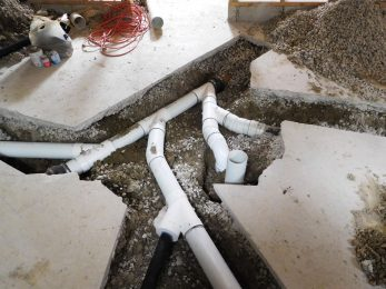 Plumbing under concrete floors